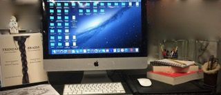 Desktop with computer and Trenzas book